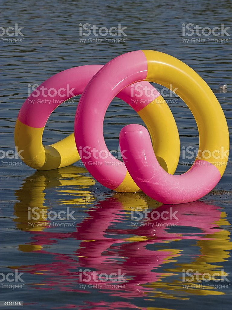 Wormlike Baloon floating on water royalty-free stock photo