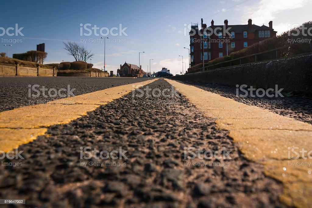 Worms eye view of double yellow lines in UK stock photo