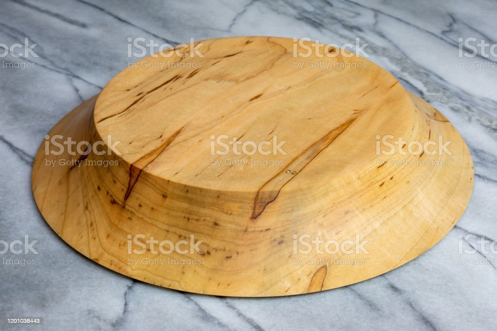 Wormy maple wood bowl hand turned Wormy maple wood bowl hand turned kitchen decor sometimes called ghost figured Art Stock Photo