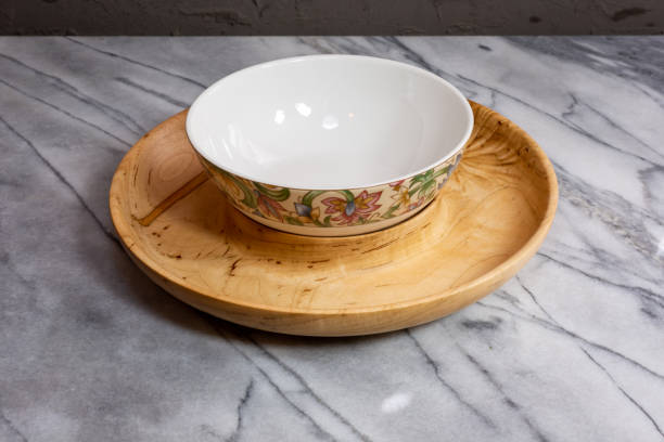 Wormy wood nut bowl and serving bowl stock photo