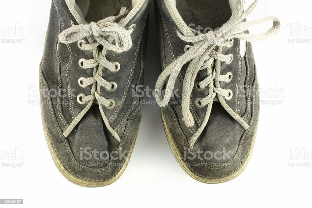Worn and dirty pair of shoes royalty-free stock photo