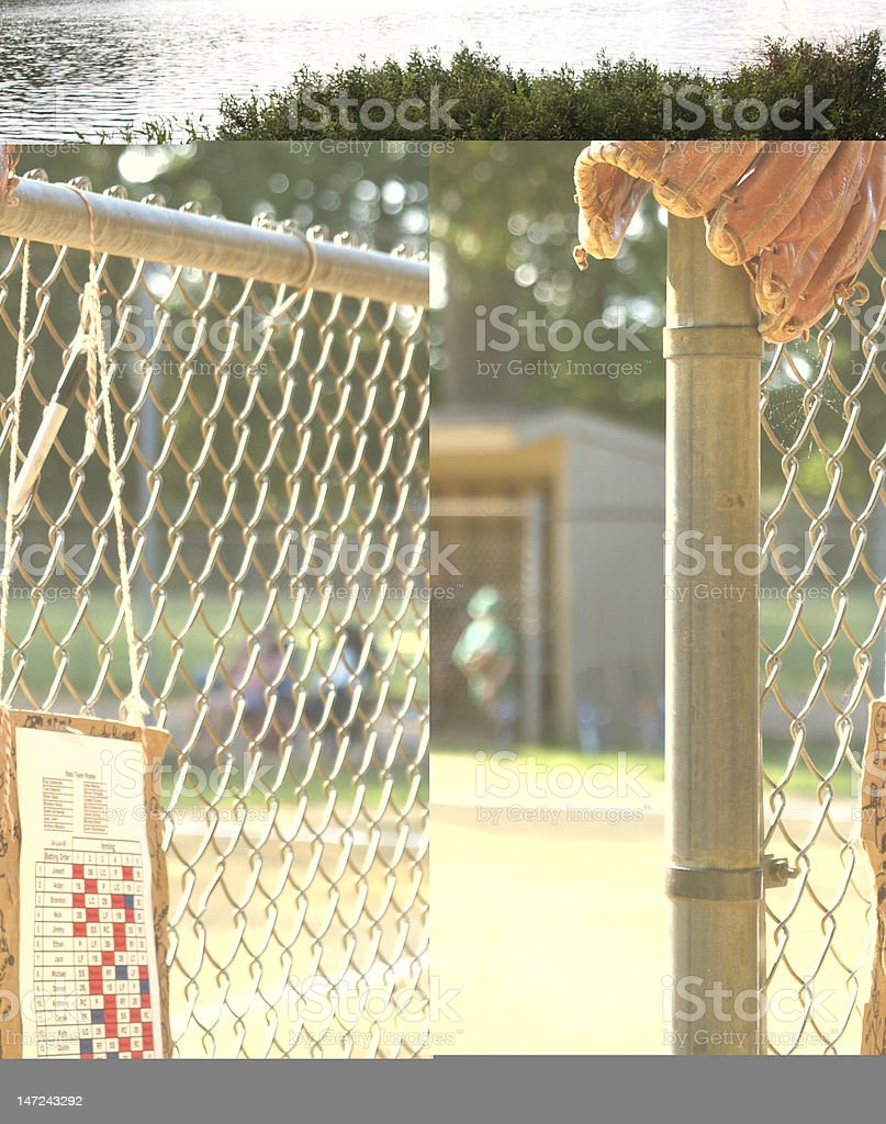 A worn basball glove propped on the corner of a wire fence with...
