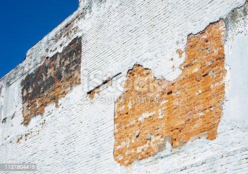 istock Worn Brick Wall on Old Building 1137804415