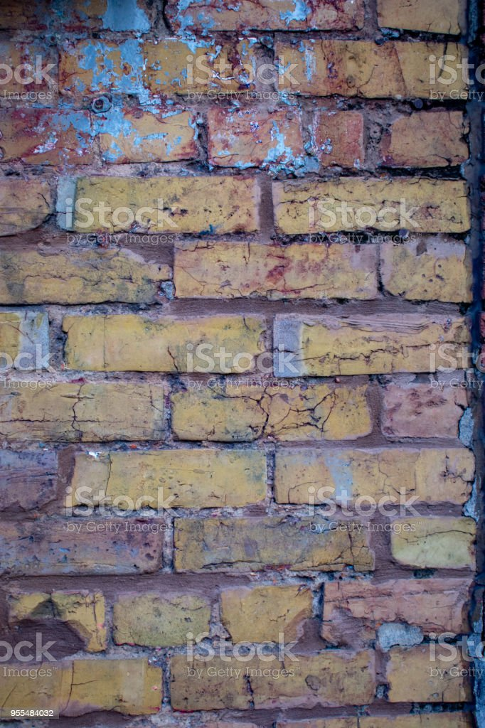worn brick wall with paint splatter stock photo