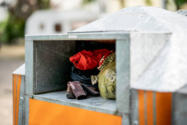 worn clothes in a container - bin stock pictures, royalty-free photos & images