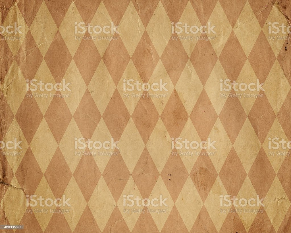 worn diamond pattern brown paper stock photo