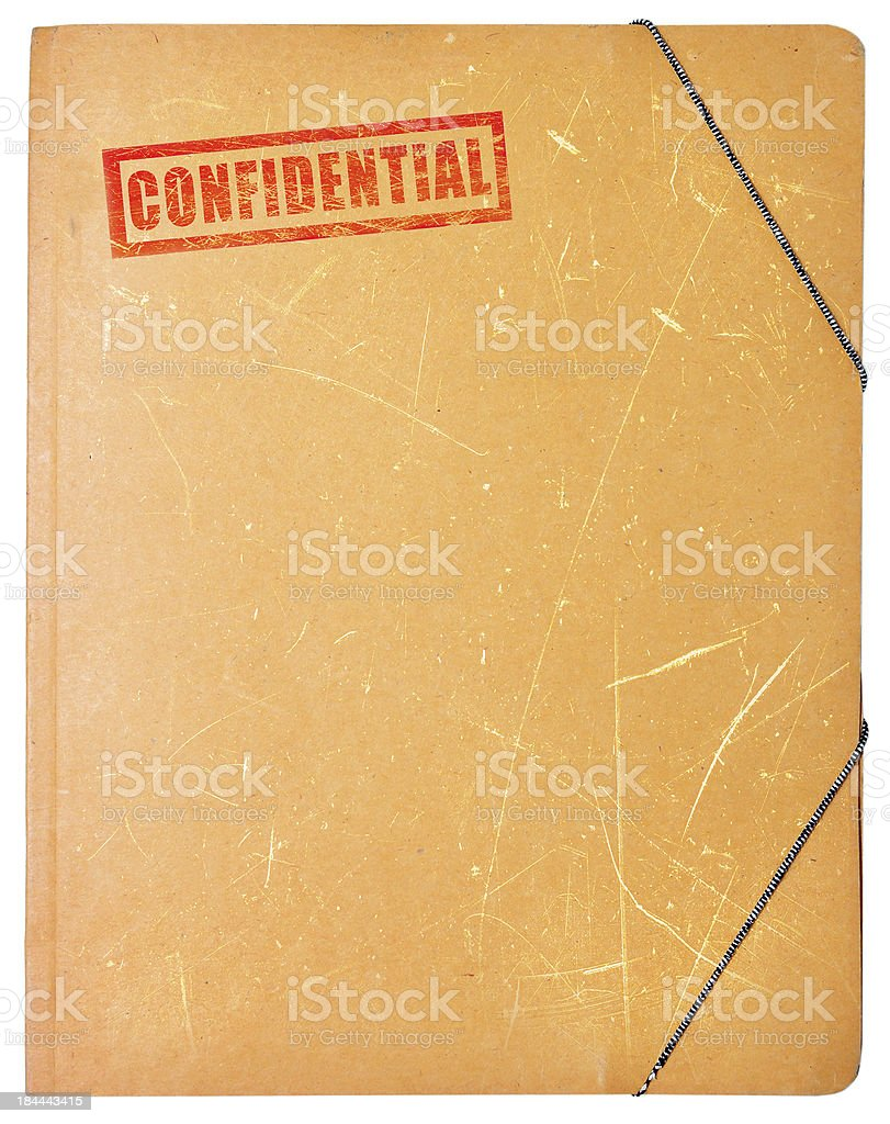 A worn folder with the word confidential written on it stock photo