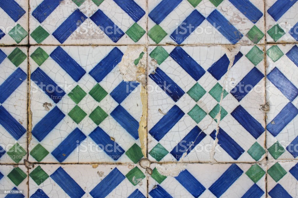 Worn geometric tiles on a building in Lisbon. stock photo