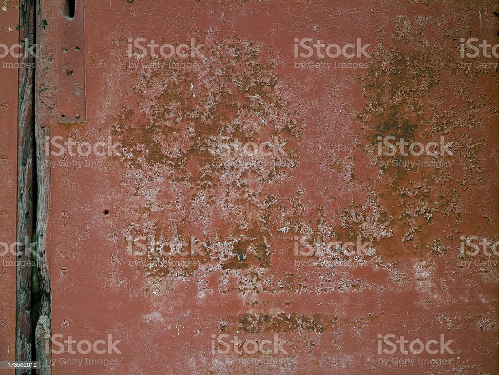Worn industrial metal door royalty-free stock photo