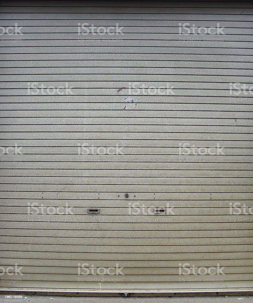 worn metal garage door gate store roller shutter royalty-free stock photo