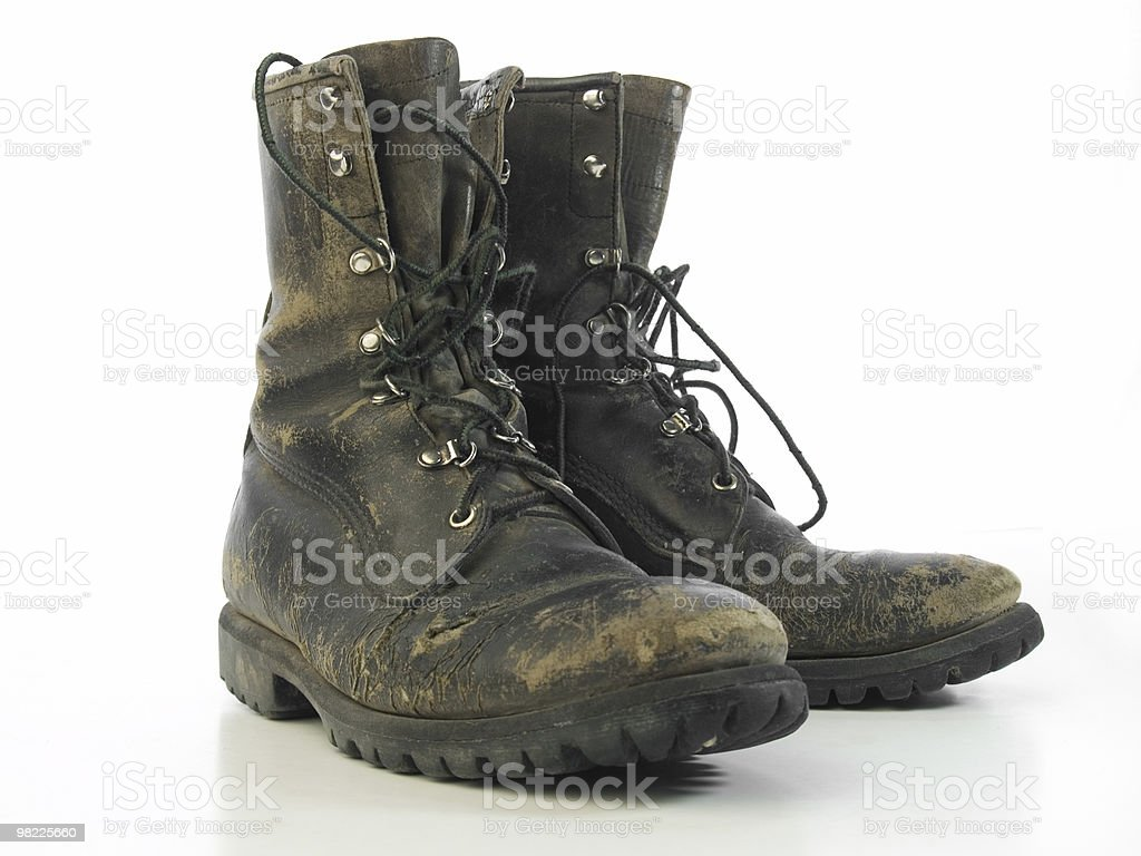 Worn old combat boots royalty-free stock photo