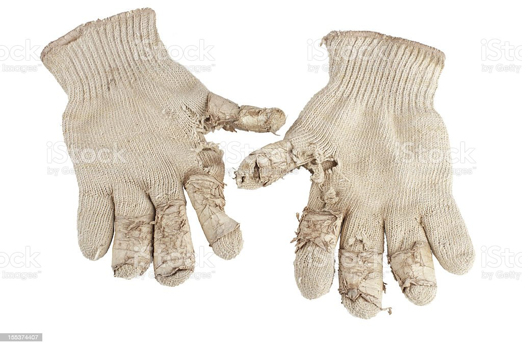 Worn out knit cotton work gloves. royalty-free stock photo