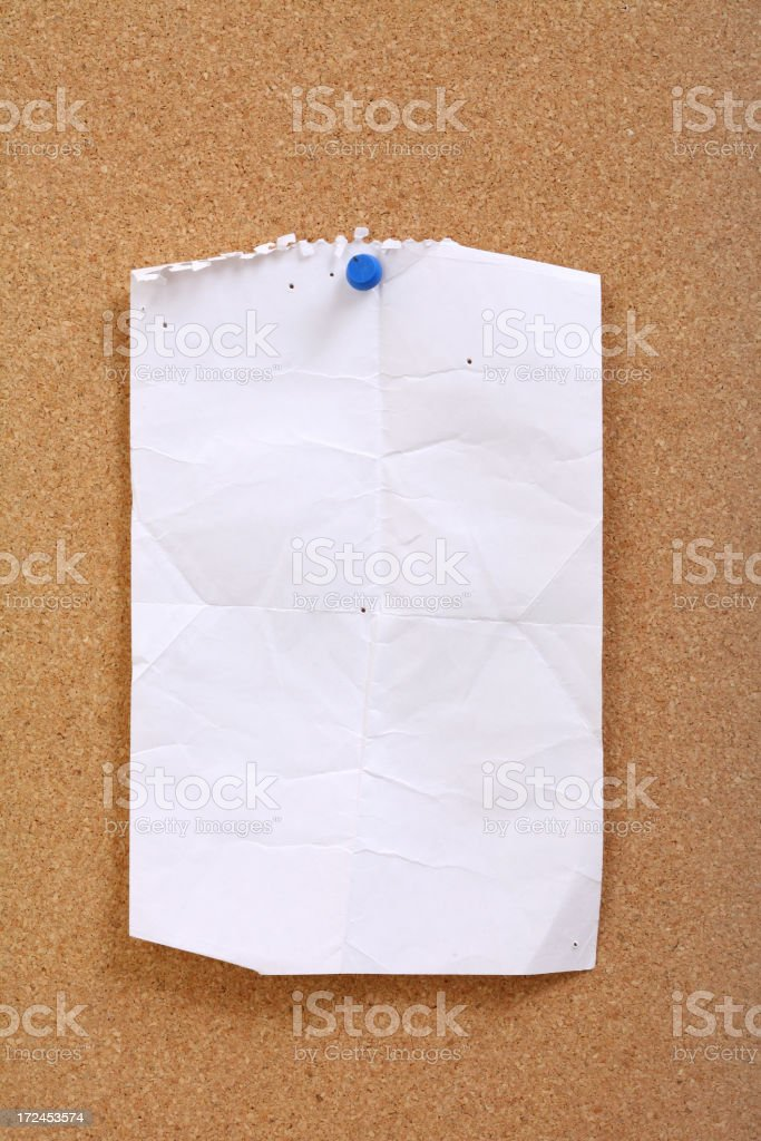 Worn out note on Corkboard royalty-free stock photo