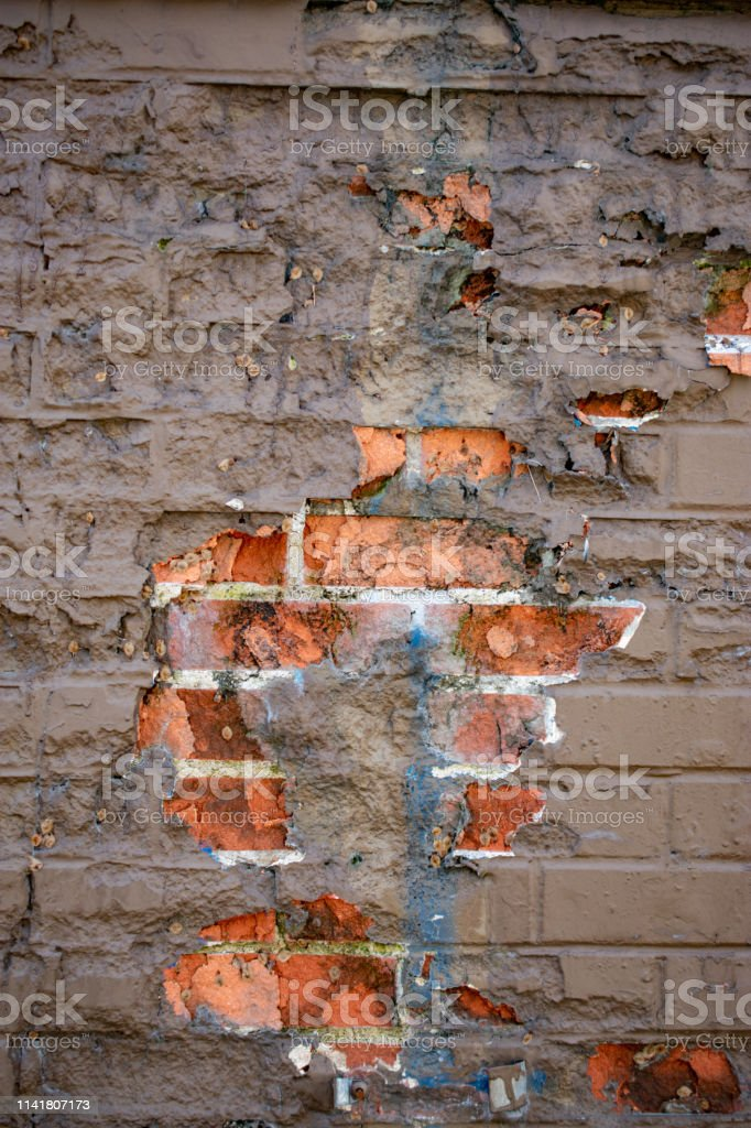 worn painted brick wall stock photo