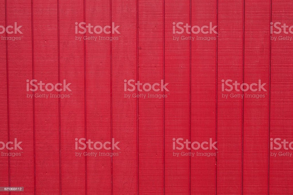 Worn rustic red barn board paneling texture stock photo