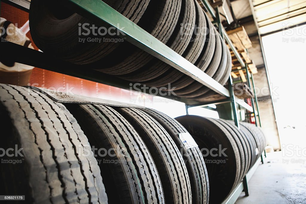 Worn & used tires in an autobody mechanic shop stock photo