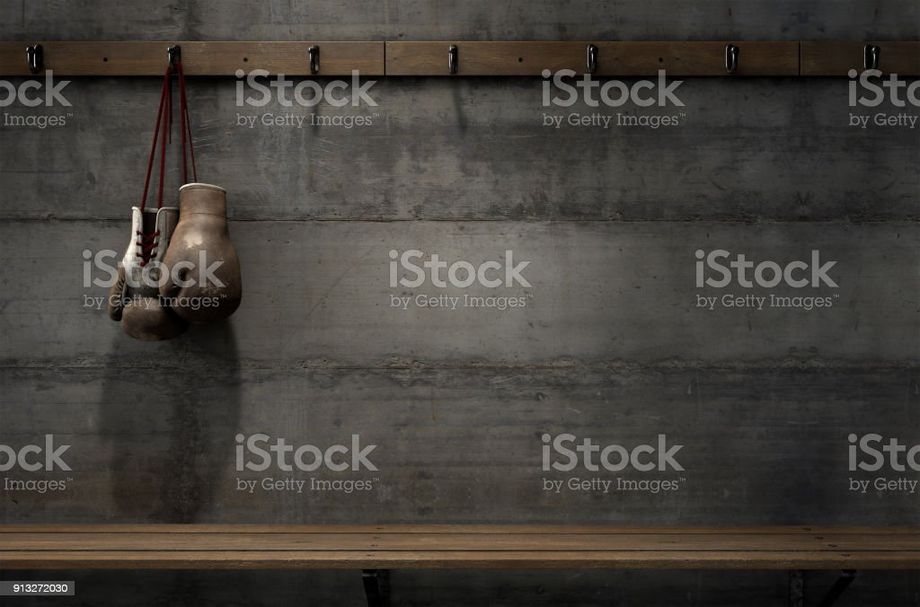 Worn Vintage Boxing Gloves Hanging In Change Room stock photo