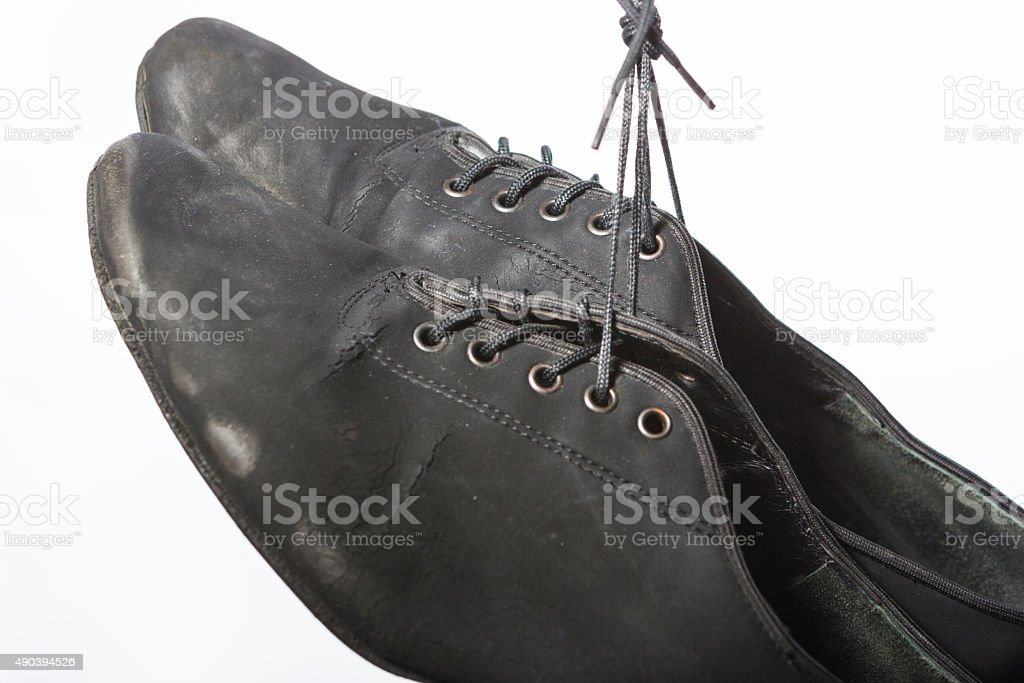 Pair of Worn-Out Latin Dance Shoes Over White Background. Horizontal...