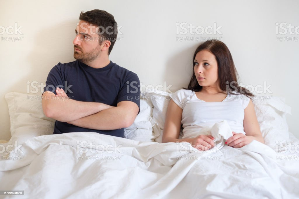 Worried and bored lovers couple after arguing royalty-free stock photo