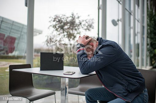 626916886 istock photo Worried and Exhausted Businessman 1135575972