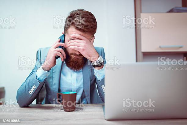 Worried and exhausted businessman talking on phone in his office picture id626916886?b=1&k=6&m=626916886&s=612x612&h=tpyzy2tual7gwghunkfptvgny nox6qvvm6m rkudvq=
