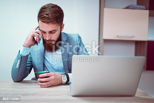 626916886istockphoto Worried and Exhausted Businessman Talking on Phone in his Office 833710090