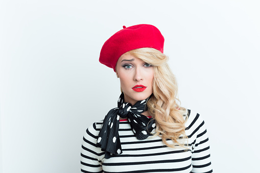 Worried Blonde French Woman Wearing Red Beret Stock Photo - Download Image Now