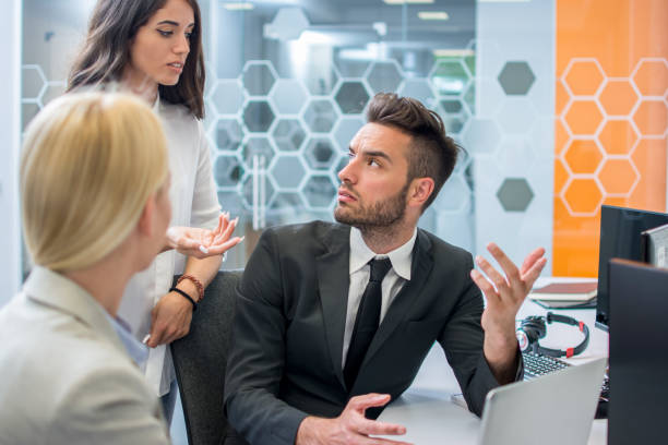 Worried business people arguing about bad finance results of company stock photo