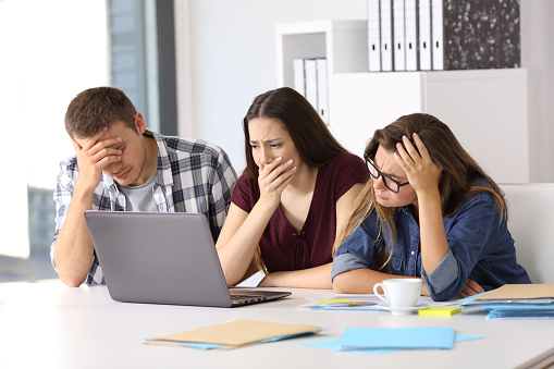 istock Worried business team watching on line content 828463804