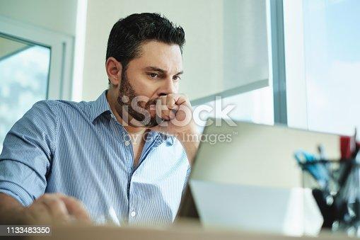 istock Worried Businessman Got Virus and Data Loss on Laptop Computer 1133483350