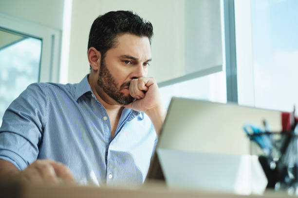 Worried Businessman Got Virus and Data Loss on Laptop Computer Angry Hispanic businessman working with laptop computer in office, losing patience. Anxious executive man under stress at work for technology problems and software pc virus. computer crime stock pictures, royalty-free photos & images