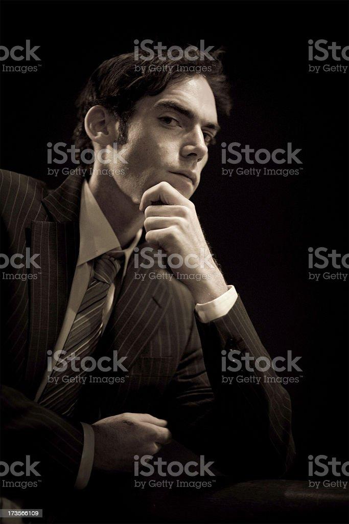 Worried businessman in dark royalty-free stock photo