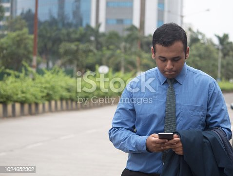 istock Worried businessman text messaging on mobile phone 1024652302