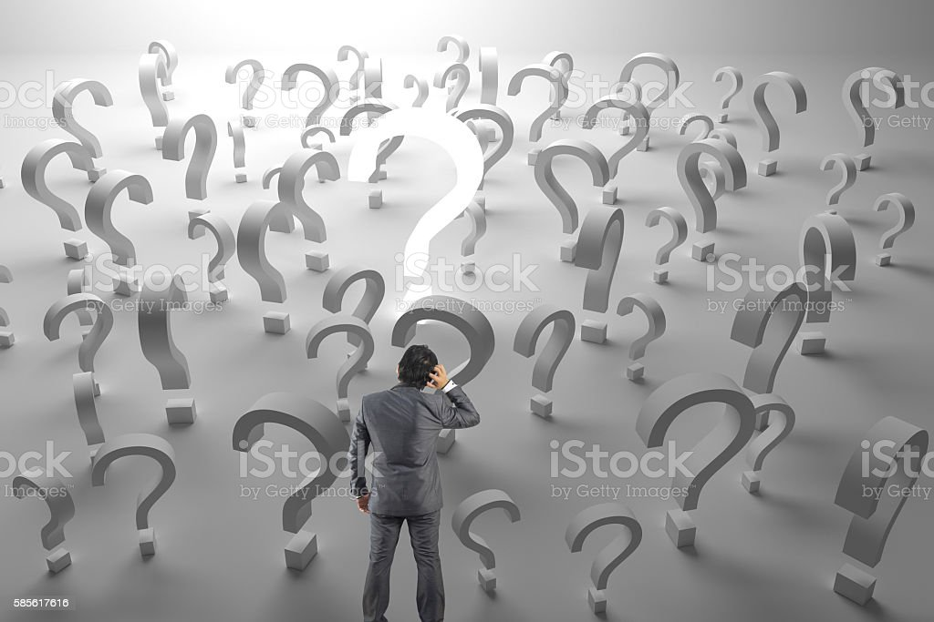 Worried businessman with many work questions unanswere stock photo