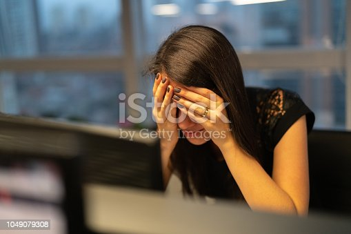 istock Worried Businesswoman at Office 1049079308