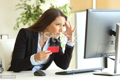 857213750istockphoto Worried businesswoman buying with credit card 638538200