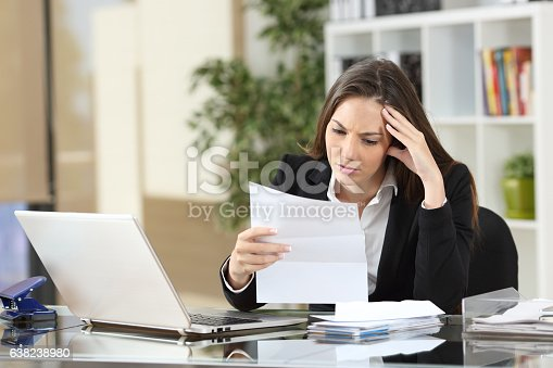 istock Worried businesswoman reading a notification 638238980