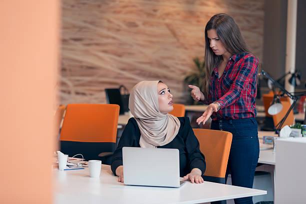 worried businesswoman receiving a notification from a colleague - kündigung arbeitsvertrag stock-fotos und bilder