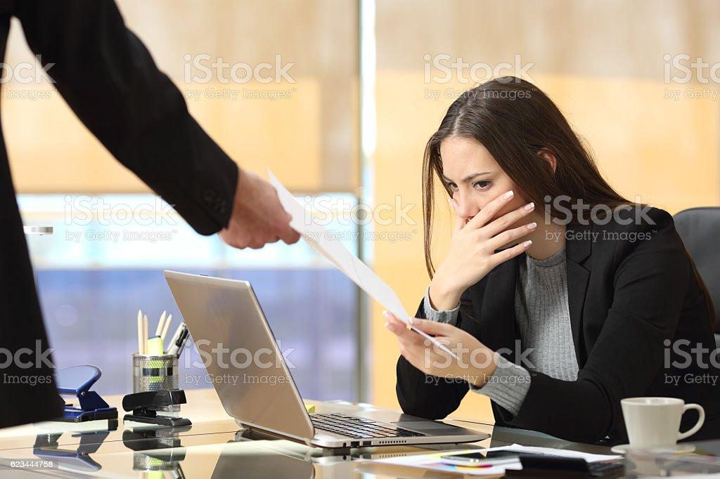 Worried businesswoman receiving notification stock photo