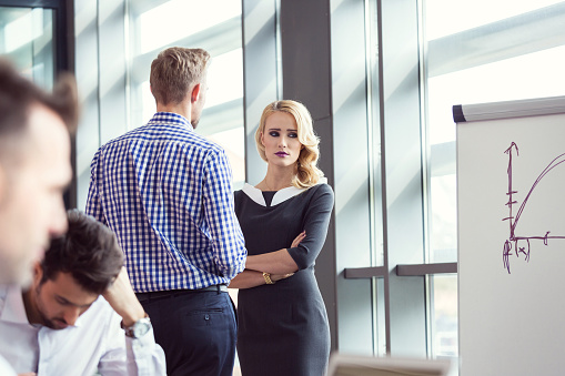 Worried Businesswoman Talking With Her Colleague In Meeting Room Stock Photo - Download Image Now