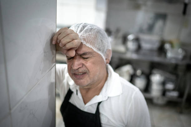 worried chef at industrial kitchen in restaurant - chef triste foto e immagini stock