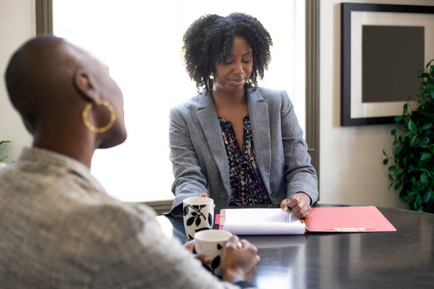 Worried Client Applying for a Loan or Businesswoman in a Meeting stock photo