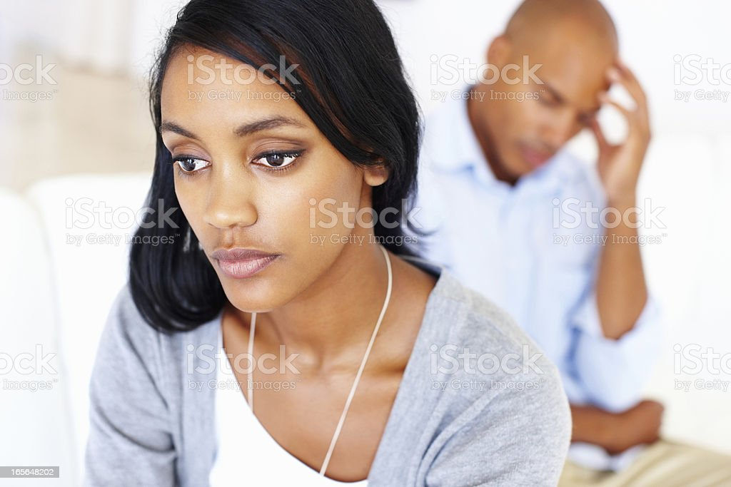 Worried couple at home stock photo