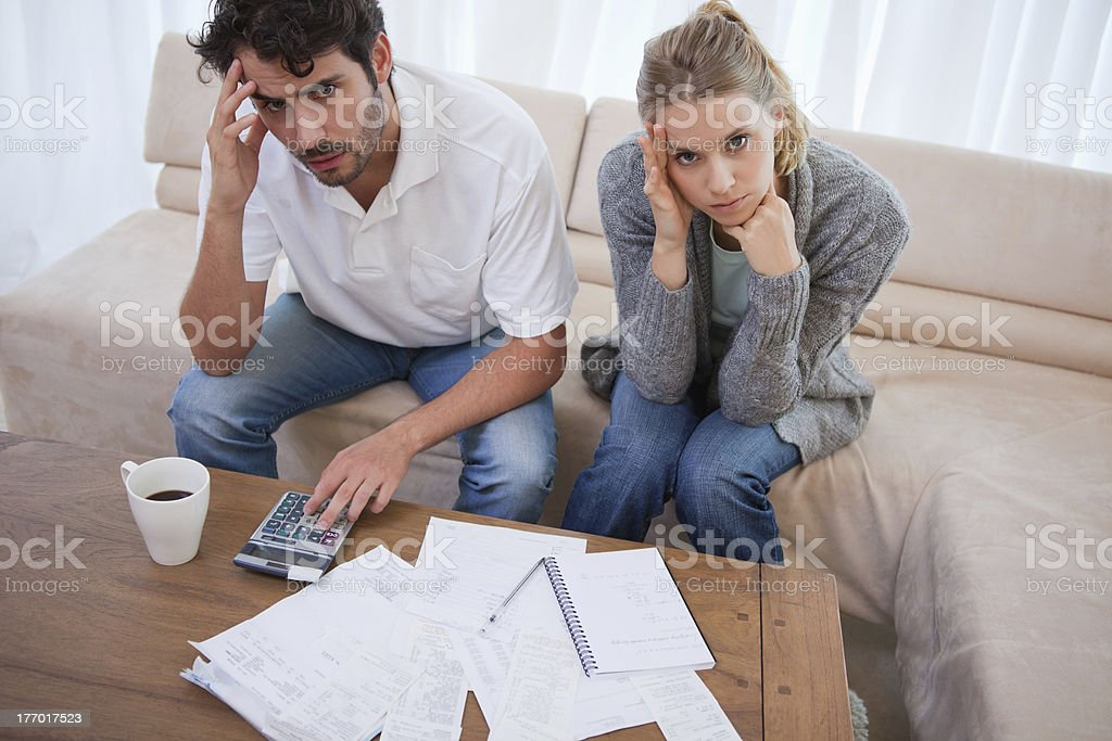 Worried couple doing their accounting stock photo