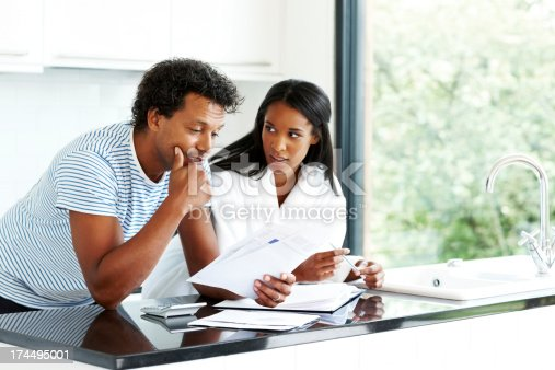 istock Worried couple working on personal finances 174495001