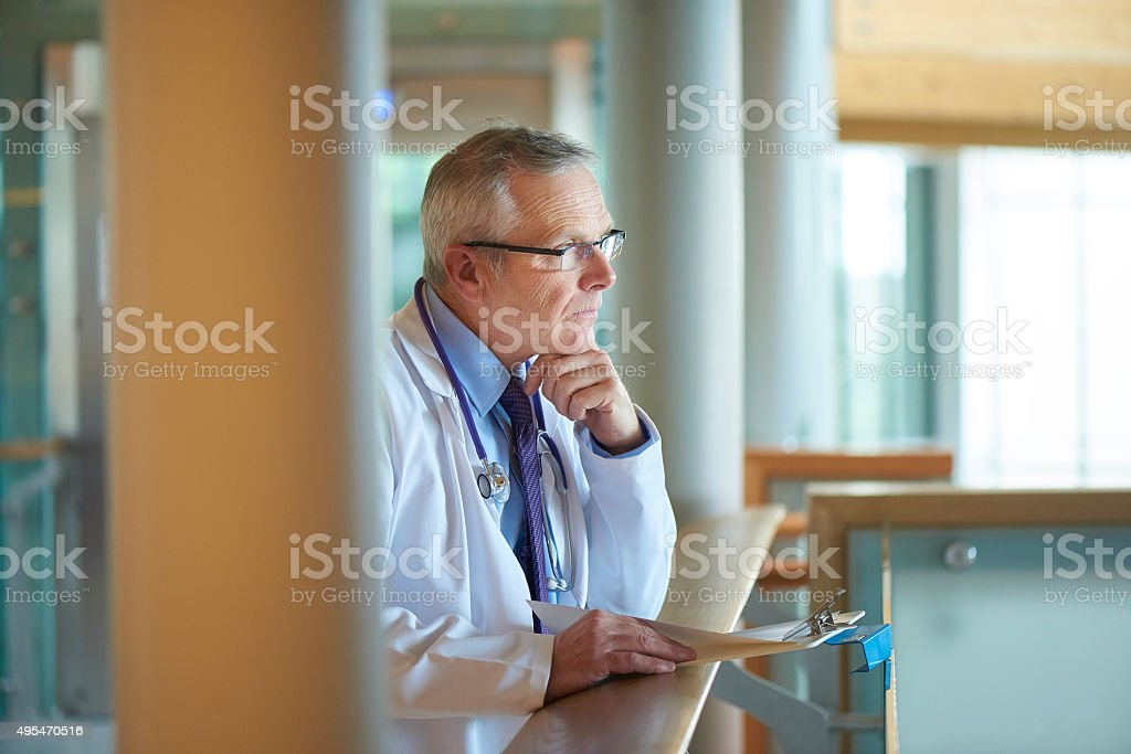 worried doctor in the house stock photo