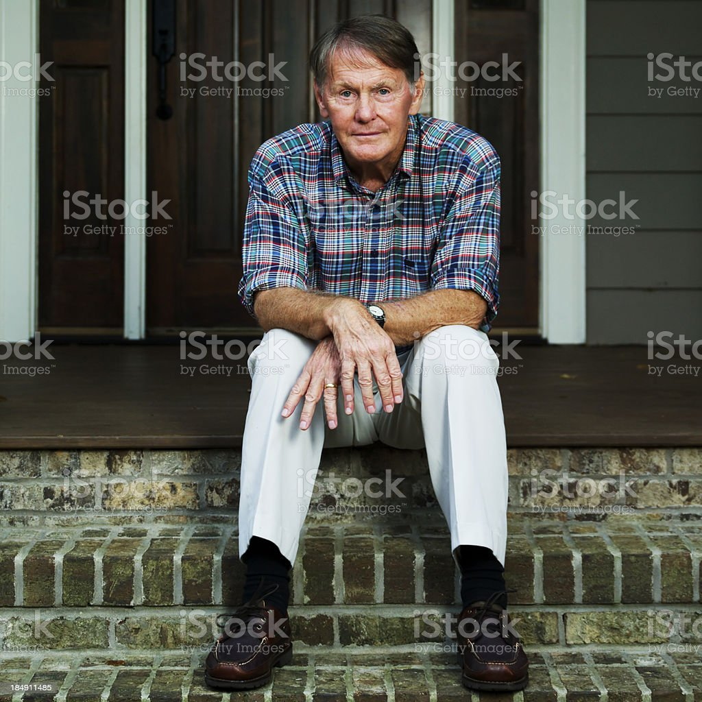 Worried Elderly Man Sitting Outside The House royalty-free stock photo