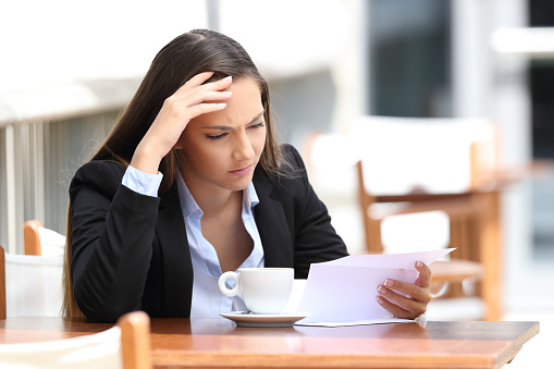 istock Worried executive reading letter in a coffee shop 836468960