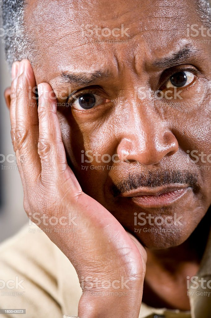 Worried face of mature African American man stock photo