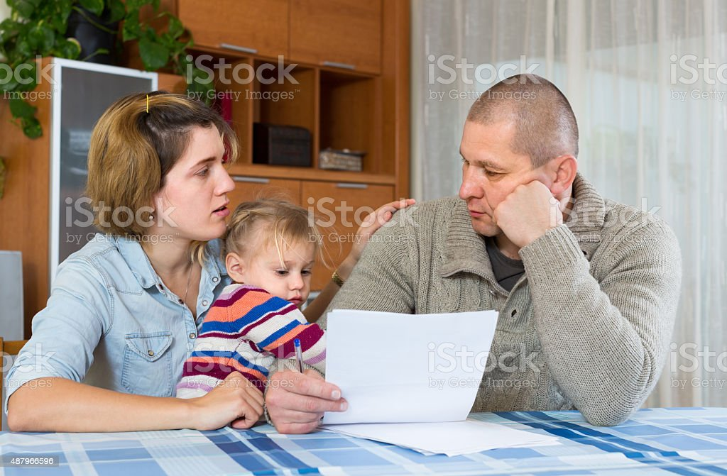 Worried family with financial documents stock photo